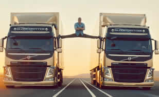 "Jean-Claude Van Damme Does ""Most Epic of Splits"" in Gravity-Defying Volvo Commercial—Watch Now!"