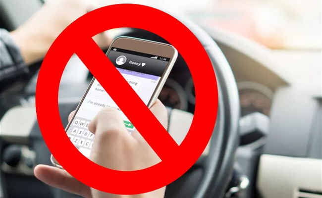 Never Use A Hand Held Mobile Phone While Driving... Know More
